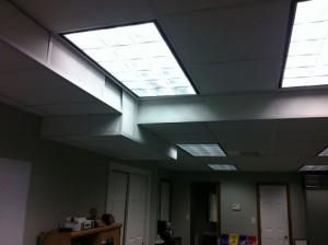 Overhead fluorescent lights in an office