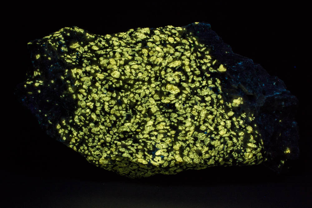 Norbergite fluorescing under shortwave ultraviolet light
