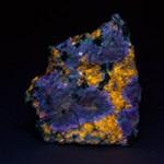Prehnite and pectolite fluorescing under shortwave ultraviolet light