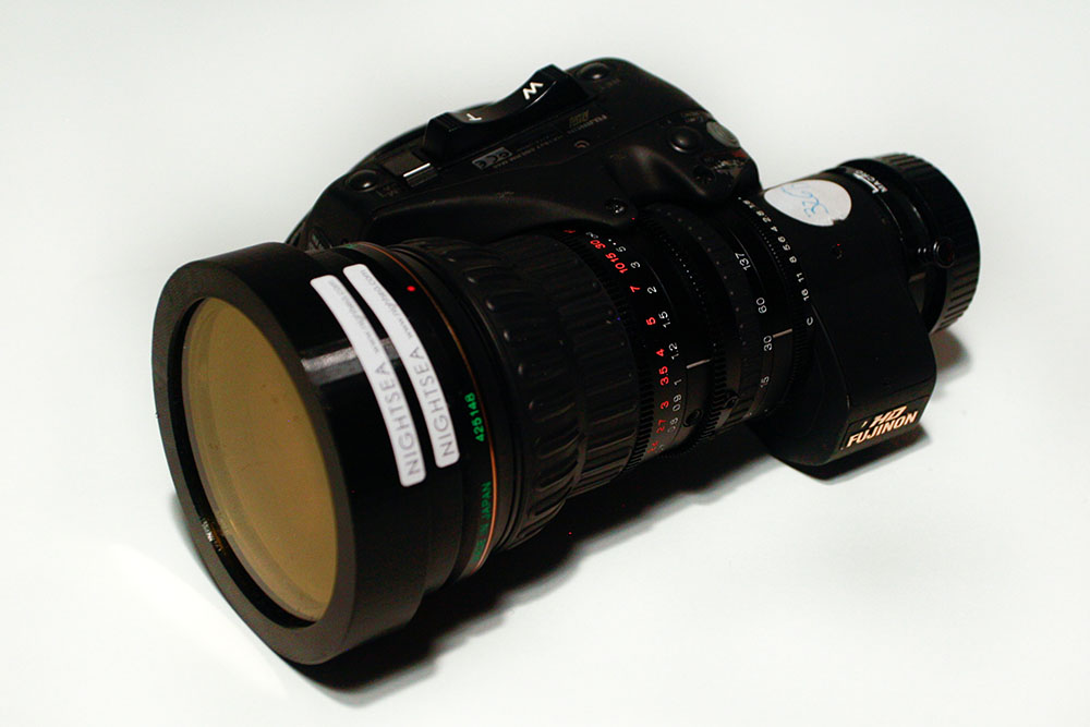 Diopter and barrier filter mounted on camera lens