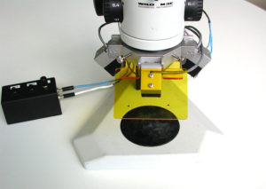 Early prototype fluorescence adapter, installed on microscope