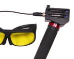Hand grip with Royal Blue light head installed and connected to the power cable, and the Royal Blue filter glasses
