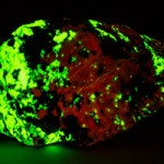 Bustamite fluorescing under blue light
