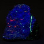 Hardystonite fluorescing under shortwave ultraviolet light