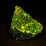 Charlesite + clinohedrite fluorescing under blue light