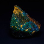 Charlesite + clinohedrite fluorescing under shortwave ultraviolet light
